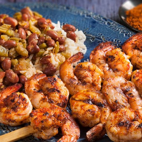 Spicy Shrimp Skewers Served with Red Beans and Rice
