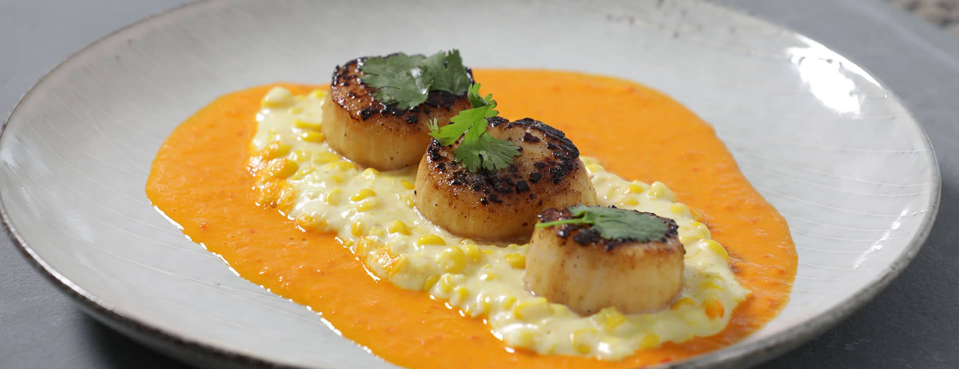 North Atlantic Sea Scallops with Creamy Corn and Red pepper Coulis